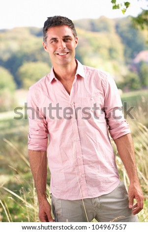 Man outdoors in countryside - stock photo