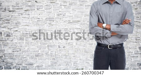 Man over grey wall background. Clothing and fashion. - stock photo
