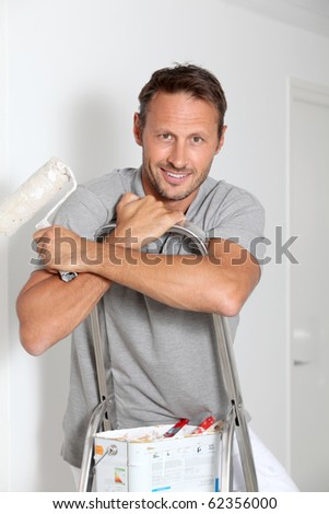 Man painting walls in white - stock photo