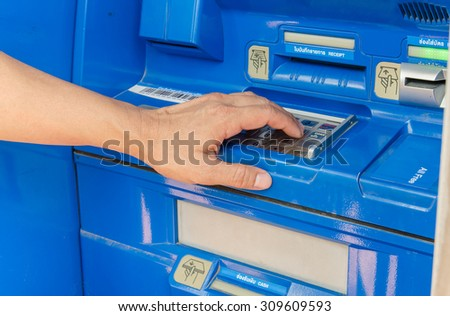 man pass ATM for Financial Transactions - stock photo