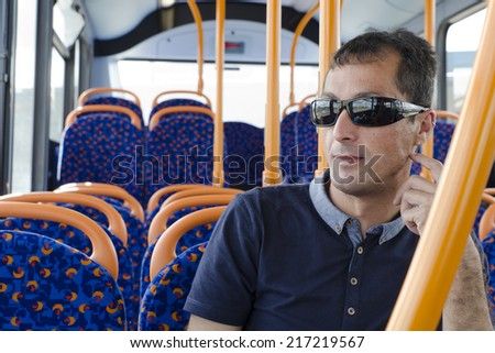 Man passenger siting on city bus, traveling by modern public transport. - stock photo