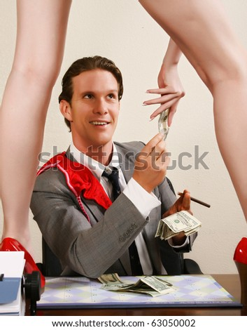Man paying for erotic dancer show in office. - stock photo