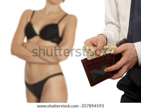 Man paying prostitute with banknotes from wallet (Dollar banknotes) - stock photo