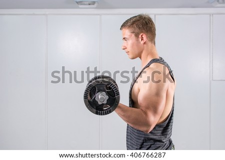 Man performing dumbbell curl at the gym. Biceps workout - stock photo