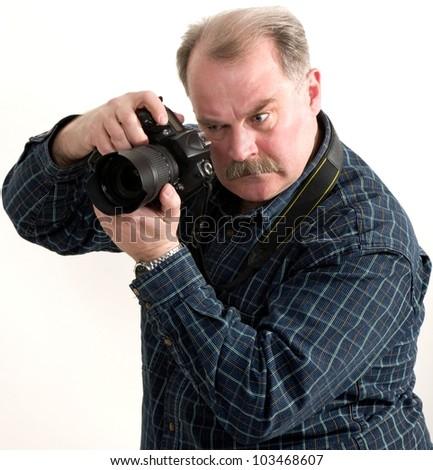 man photographer doing photos by digital camera isolated - stock photo