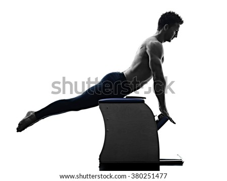 man pilates chair exercises fitness isolated - stock photo