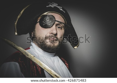 man pirate with eye patch and old hat with funny faces and expressive - stock photo