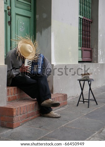 Man Playing Accordion in Old San Juan Doorway - stock photo