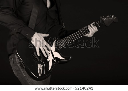 Man playing an electrical guitar - stock photo