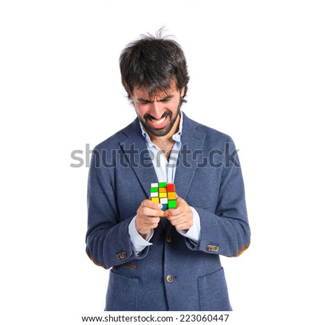 Man playing an intelligence game over white backgrpund - stock photo