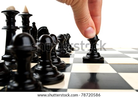 man playing chess and board isolated on a white background - stock photo
