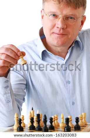 Man playing chess, isolated on white background - stock photo