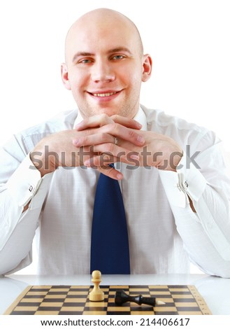 Man playing chess, sitting on the desk - stock photo