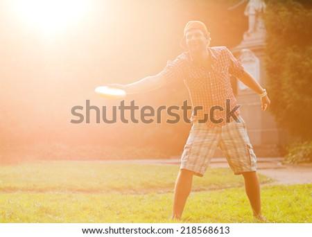 man playing frisbee at its yard - stock photo