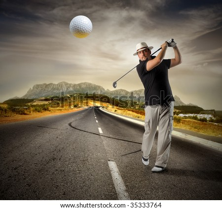 man playing golf on the road - stock photo