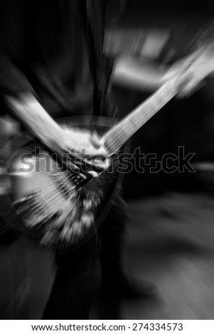 man playing rock guitar on concert, blurred rock background - stock photo