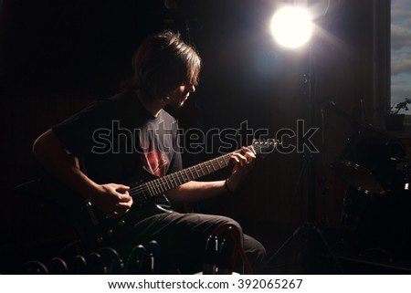 man playing rock music by electric guitar - stock photo