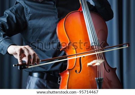 Man playing the cello - stock photo