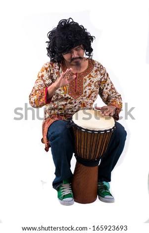 Man playing the djembe - stock photo