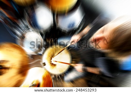 Man playing the drum.Live music abstract background concept.Drummer and rock music - stock photo