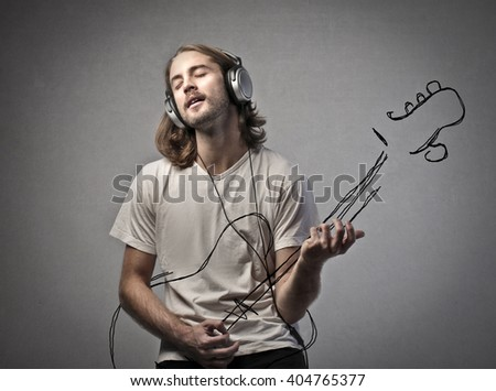 Man playing the guitar - stock photo