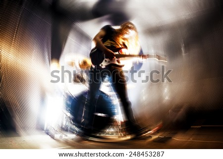 Man playing the guitar.Abstract Live music background concept.Guitar player and rock music concept - stock photo