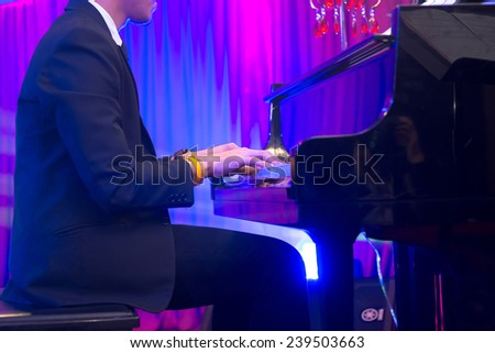 Man playing the piano - stock photo