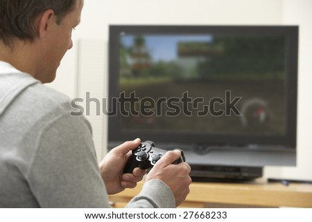 Man Playing With Game Console - stock photo