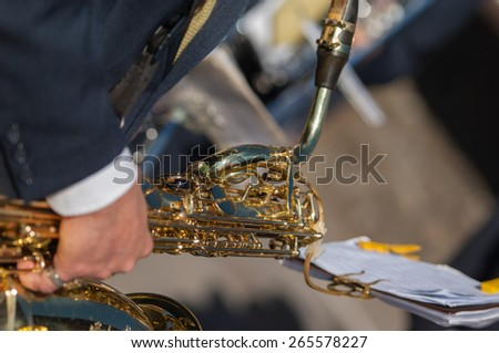 man plays the trombone during a religious ceremony - stock photo
