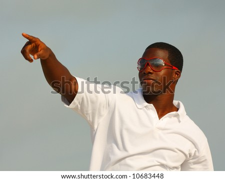 Man Pointing At Someone - stock photo