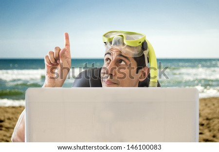 man pointing his finger to the place of your next vacation in beach - stock photo