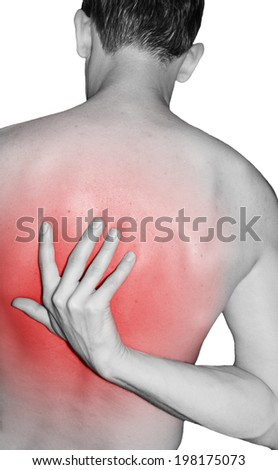 Man pointing to back injury - stock photo