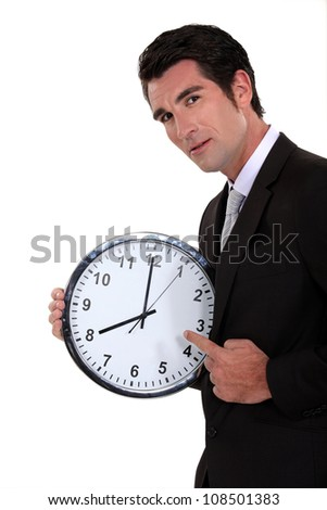 Man pointing to clock - stock photo