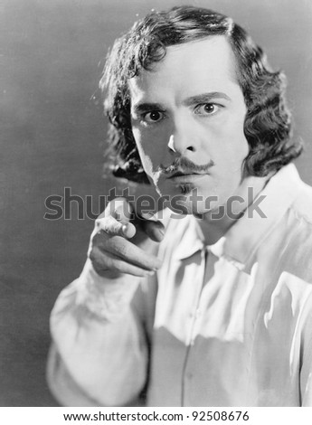 Man pointing with his finger and looking angry - stock photo