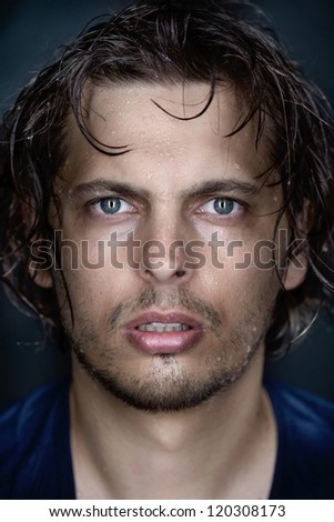 man portrait fine art wet face conceptual looking at camera - stock photo