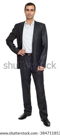 Man portrait in black suit on white at studio - stock photo