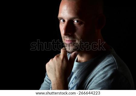 Man portrait on black background. - stock photo