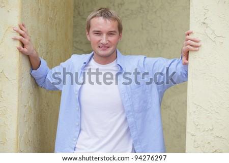 Man posing between two walls - stock photo