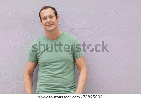 Man posing in a green shirt - stock photo
