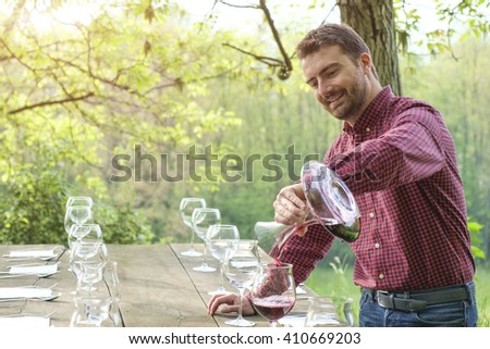 Man pour red wine - stock photo