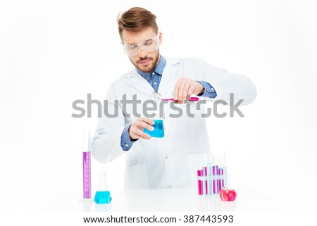Man pouring chemicals isolated on a white background - stock photo