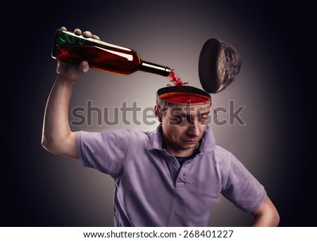 Man pours his head on with alcohol  - stock photo