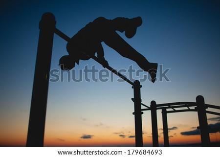 Man practice street workout - stock photo