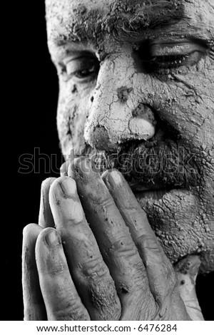 Man praying isolated on black - stock photo