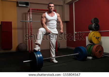 Man preparing to do dead lift - stock photo