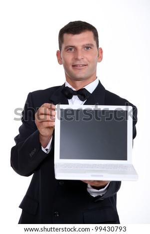 Man presenting laptop - stock photo