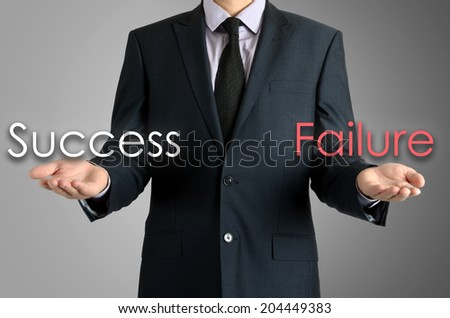 man presents with their hands for a decision problem between success or failure on grey background - stock photo