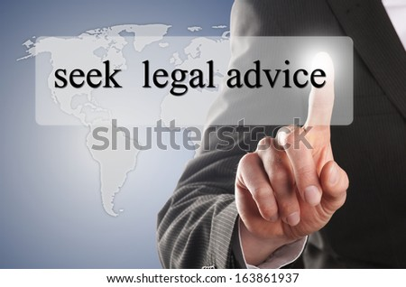 "man press the button with the message ""seek legal advice"" on it - stock photo"