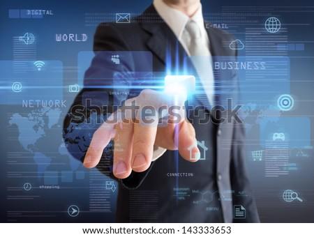 man pressing a multimedia computer display  - stock photo