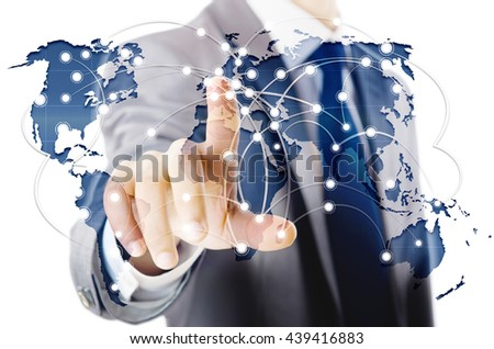 Man pressing dots on world map in global communication concept - stock photo